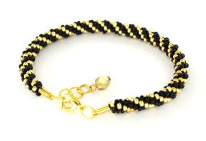 Bransoletka czarno złota z zapięciem i koralikiem