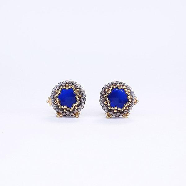 Kolczyki w kolorze starego złota z niebieskim oczkiem